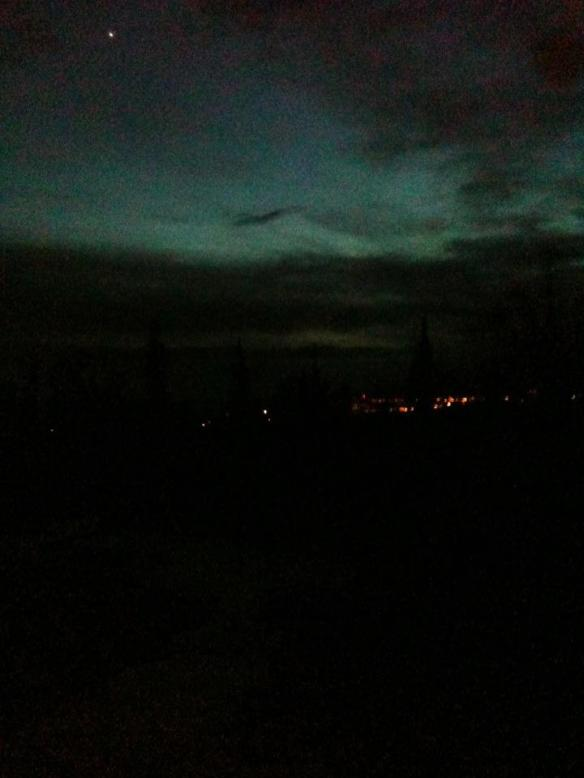 I stuck my arm out the window to get a pic of downtown Anchorage, caught Venus in the shot, too.